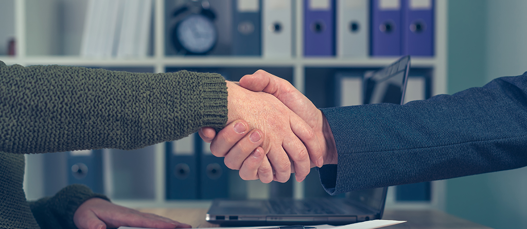 man-and-woman-shaking-hands-over-business-resized